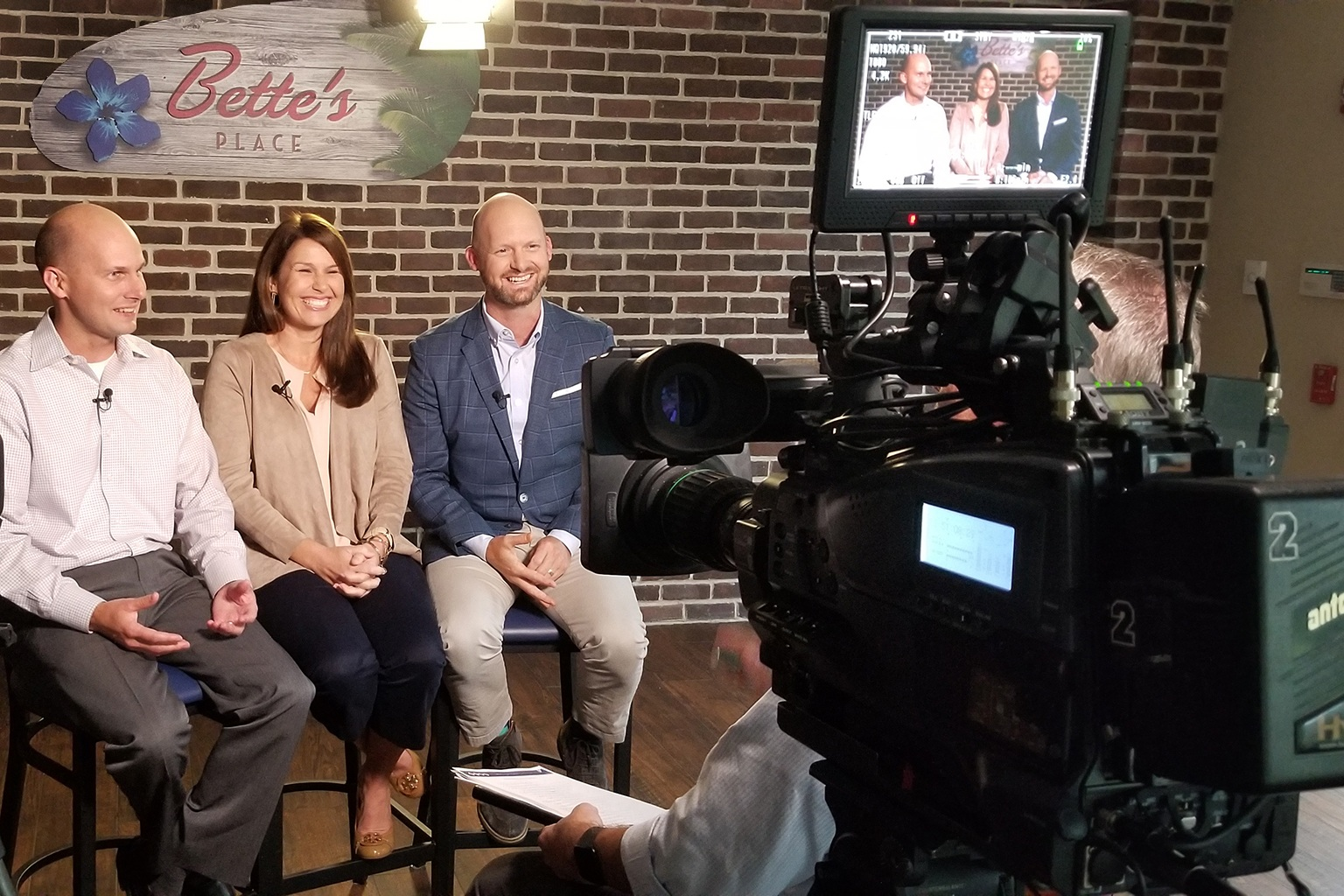 A picture of an interview being recorded for production.