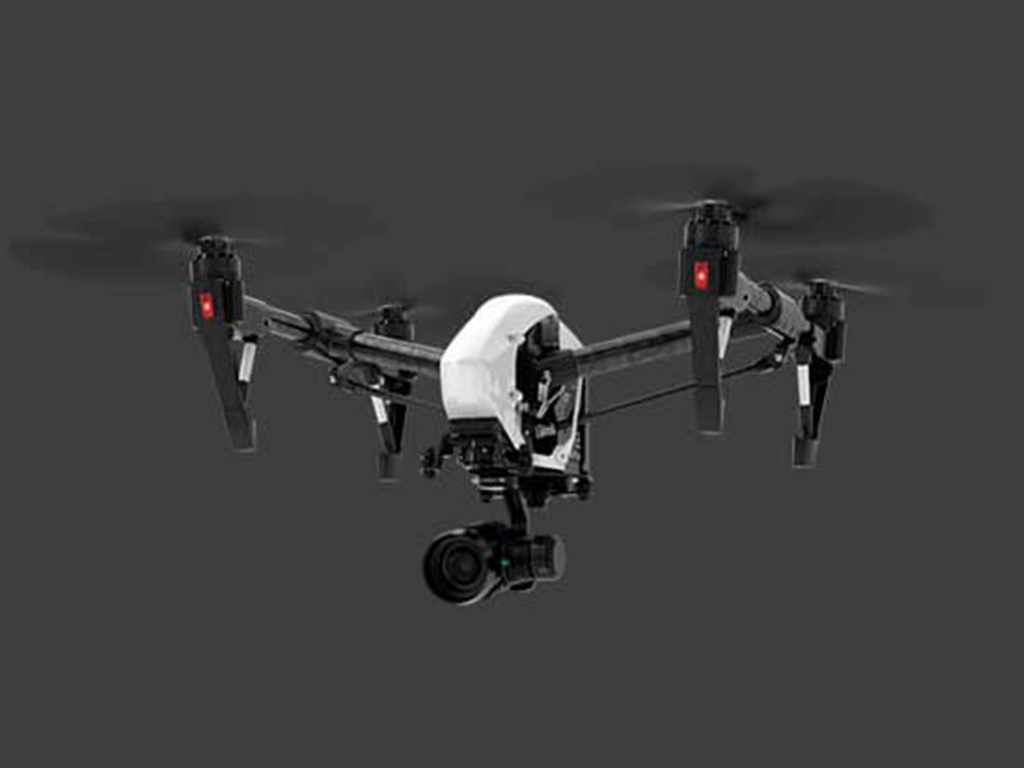 Picture of a high-end DJI Camera drone in flight, one of two we operate.